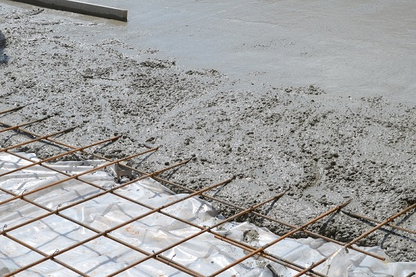 Wet concrete over rebar frame